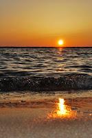 Sunset over Beach - Photo by Rachel Cook on Unsplash.com