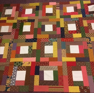 scrap quilt of fall colors