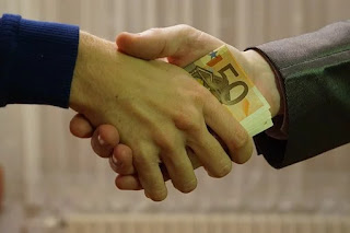 Money being exchanged to meet an urgent need