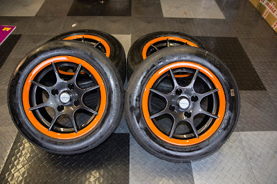 Caterham R500 13 inch 8 spoke alloy wheels with painted orange rim and Avon CR500 tyres
