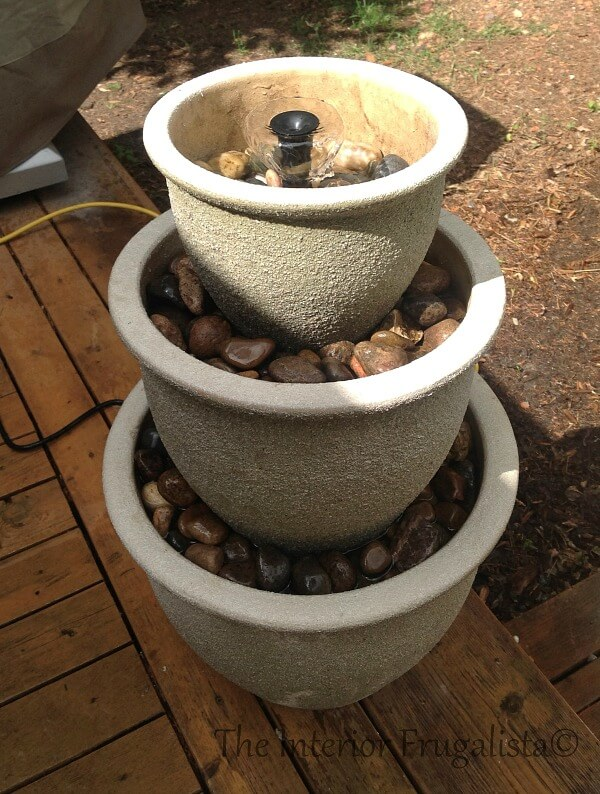 This budget-friendly DIY Plant Pot Water Fountain is the perfect water feature for a deck, patio, porch, or balcony using a trio of flower pots.