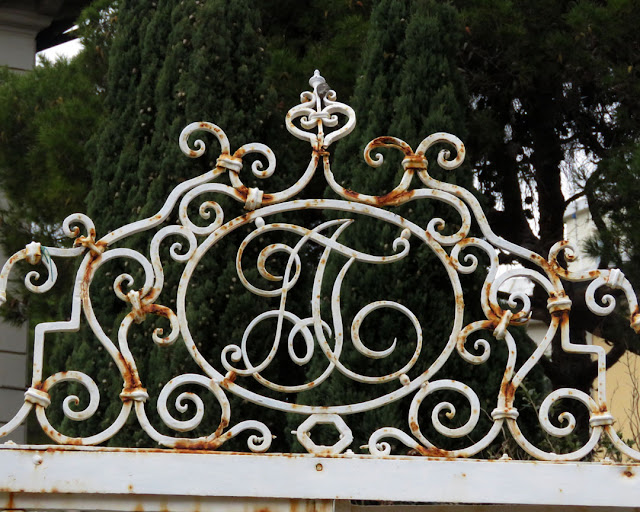 A monogram on a gate, Via Borsi, Livorno