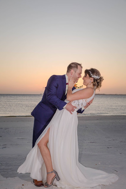 Romantic sunset photos of groom and bride on Fort Myers Beach.