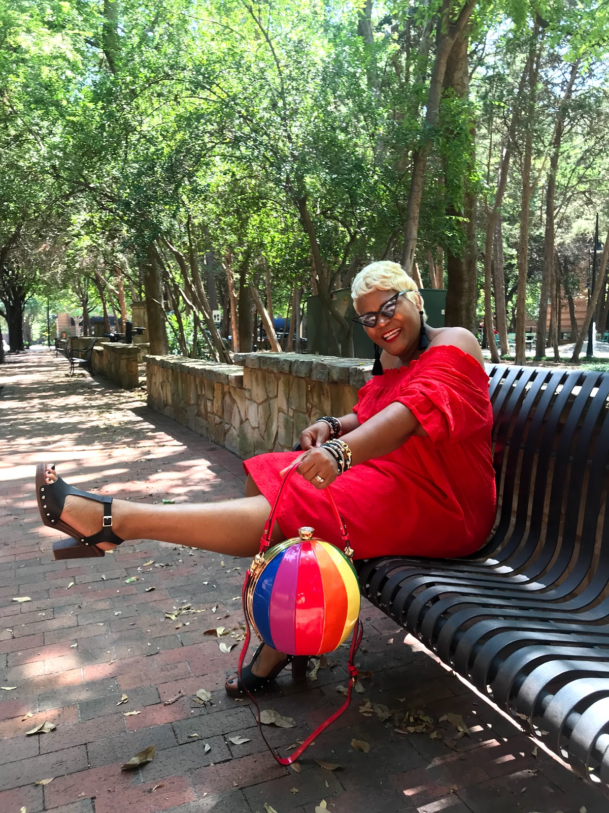 Image: Tangie Bell sharing her outfit deets in a red dress from H&M. Seen first on Bits and Babbles blog. Also talks about the heat and Cooter Brown meanings. Fun post by Tangie Bell