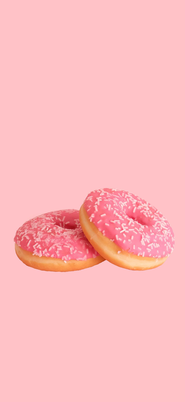 خلفية كعكات الدونات الوردية بنكهة الفراولة