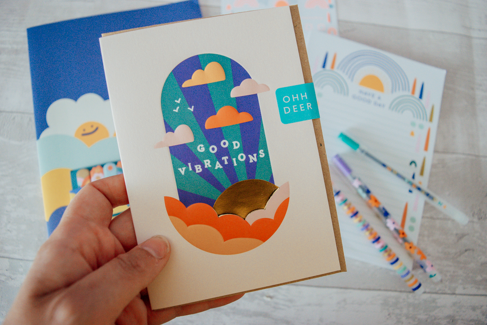 A greeting card with the quote 'good vibrations' on the front