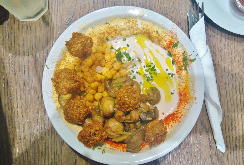 Bowl of hummus and falafel in Budapest