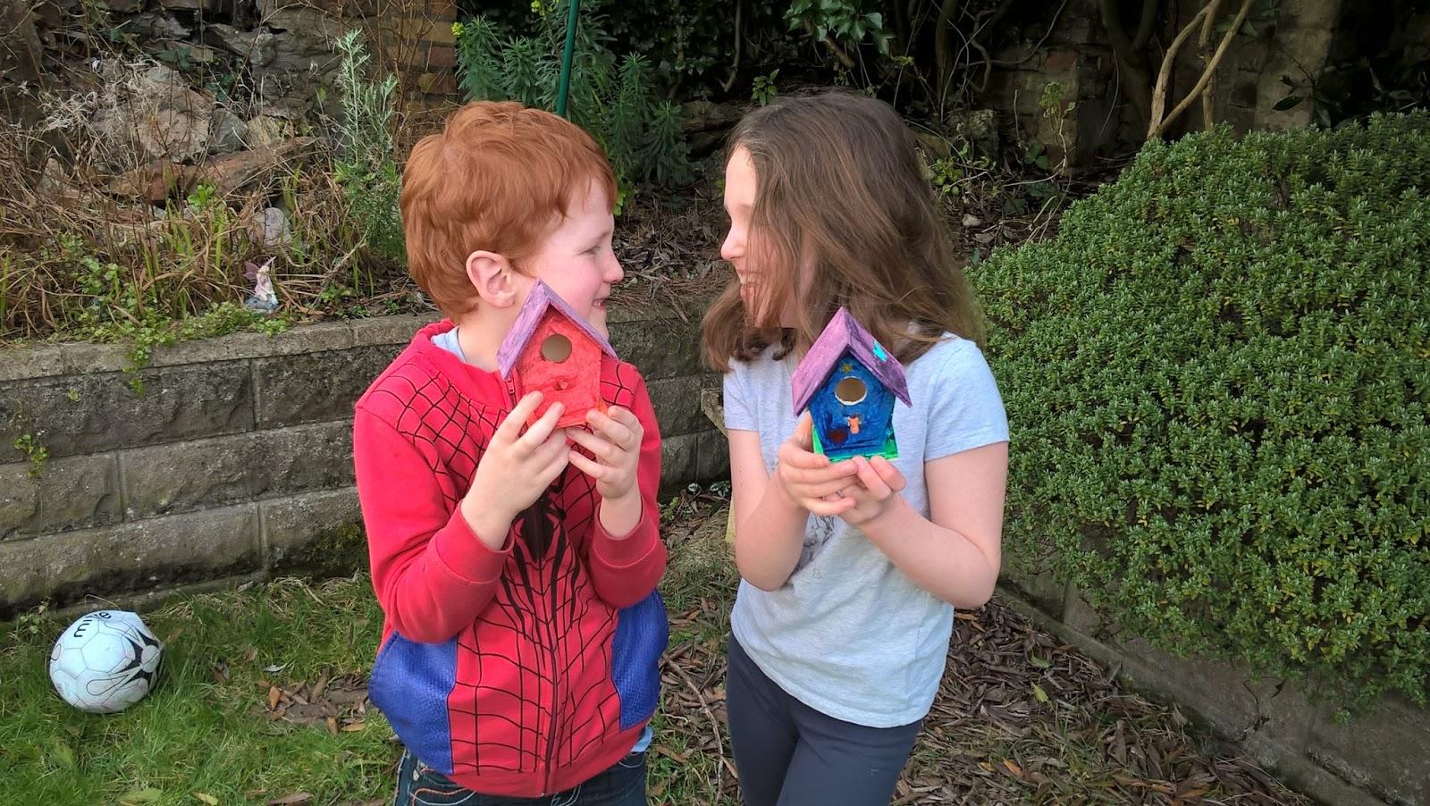 Caitlin & Ieuan Hobbis with mini bird houses in the garden - Surcare Help A Hand Challenge - motherdistracted.co.uk