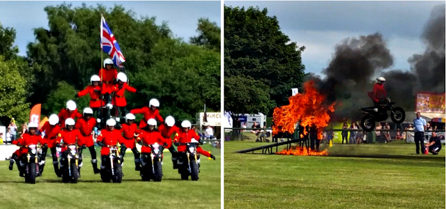 A motorcycle team doing their tricks. Jumping through fire.