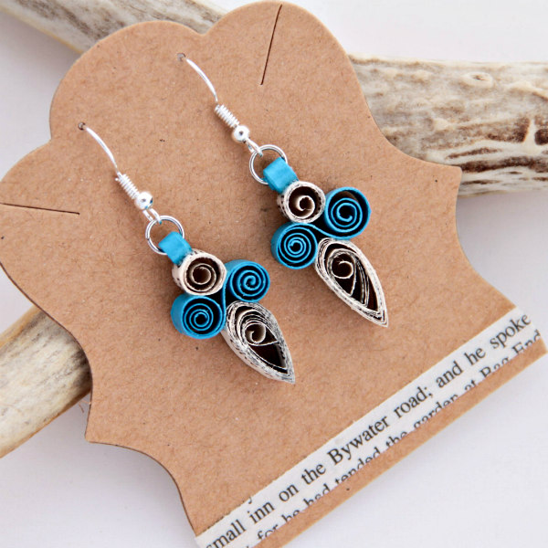 Quilled earrings made of turquoise paper and book page strips