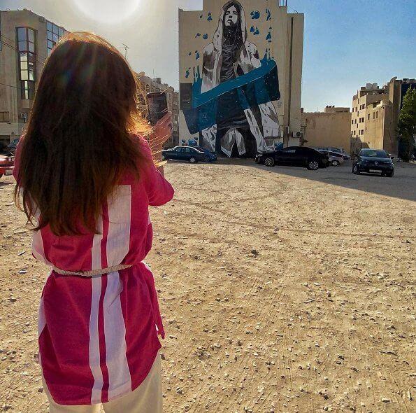 Queen Rania of Jordan wore a zoya striped voile cotton tunic from LemLem. The Baladk Street Urban Arts and Graffiti Festival in Amman