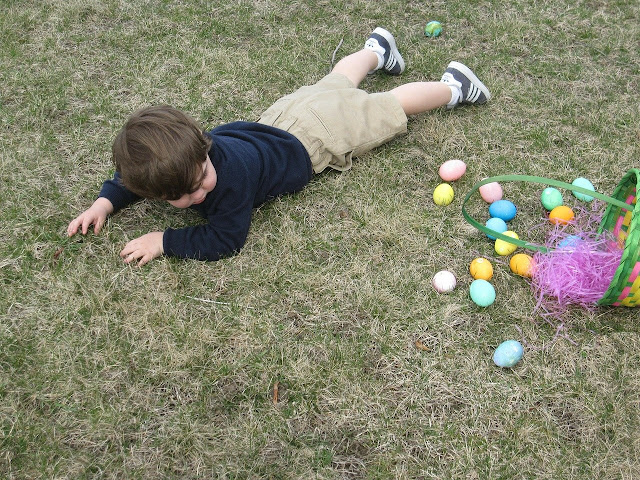 Child falling over with Easter eggs