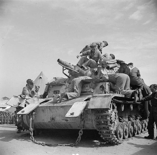 Examining a captured Panzer IV on 16 March 1942 worldwartwo.filminspector.com