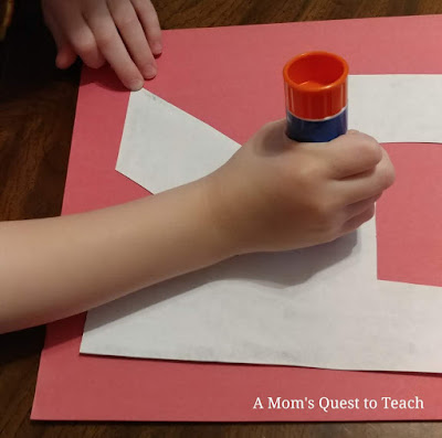 gluing letter R onto red construction paper