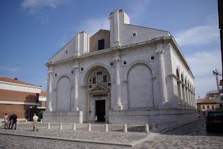 The 13th century Tempio Maletestiano in Rimini has frescoes by Piero della Francesca and works by Giotto