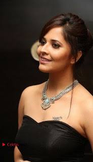 Telugu Anchor Actress Anasuya Bharadwa Stills in Strap Less Black Long Dress at Winner Pre Release Function  0005.jpg