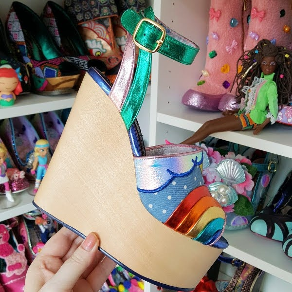 wooden wedge platform shoe in hand with colourful uppers