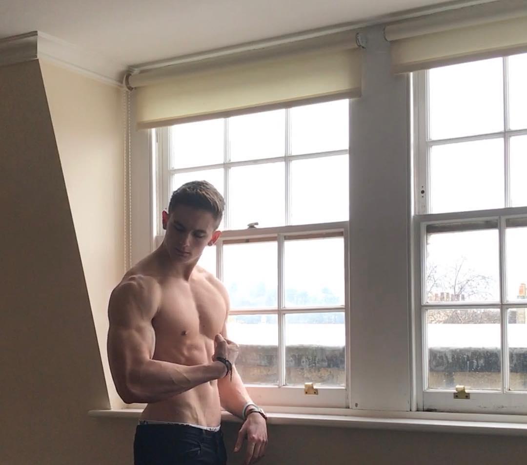 shirtless-sexy-boy-next-door-flexing-big-biceps