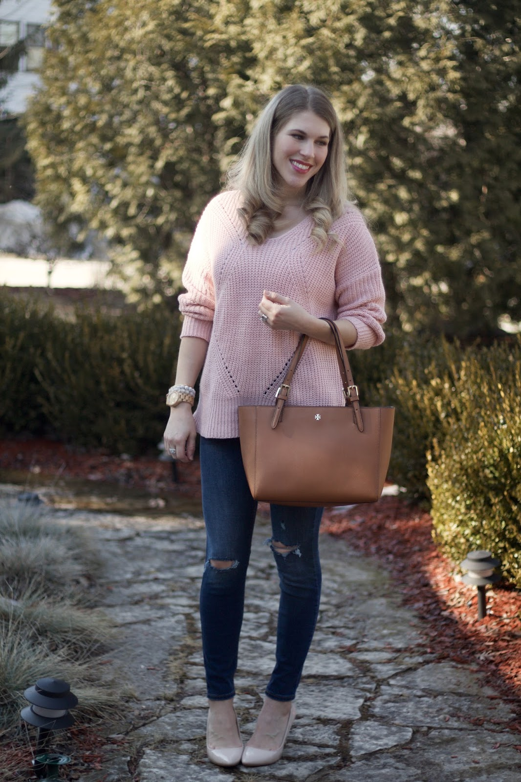 pink lace up back sweater, distressed jeans, Tory Burch tote, nude heels