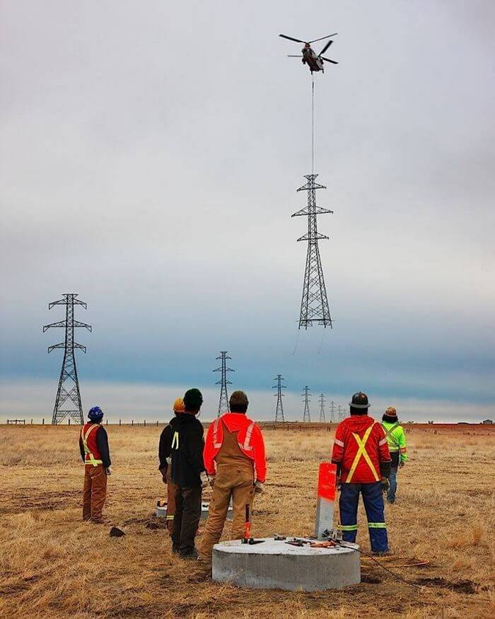 The process of installing a huge power transmission tower