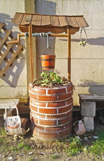 Poço completo feito de pneus usado como floreira