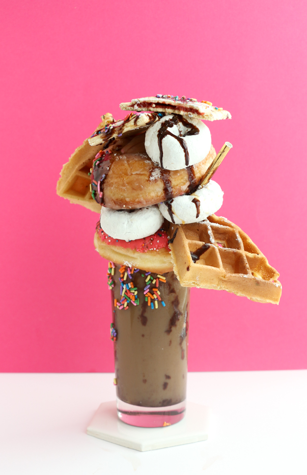 Learn how to make the ultimate breakfast freak shake using iced coffee, waffles, donuts, cinnamon rolls, and pop tarts - amazing brunch food ideas - brunch recipes, dessert, freak shake