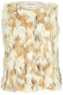 https://ad.zanox.com/ppc/?36459306C76146881&ulp=[[http://www.riverisland.fr/women/sale/coats--jackets/cream-patchwork-faux-fur-gilet-669754?cmpid=af_Zanox_FR]]