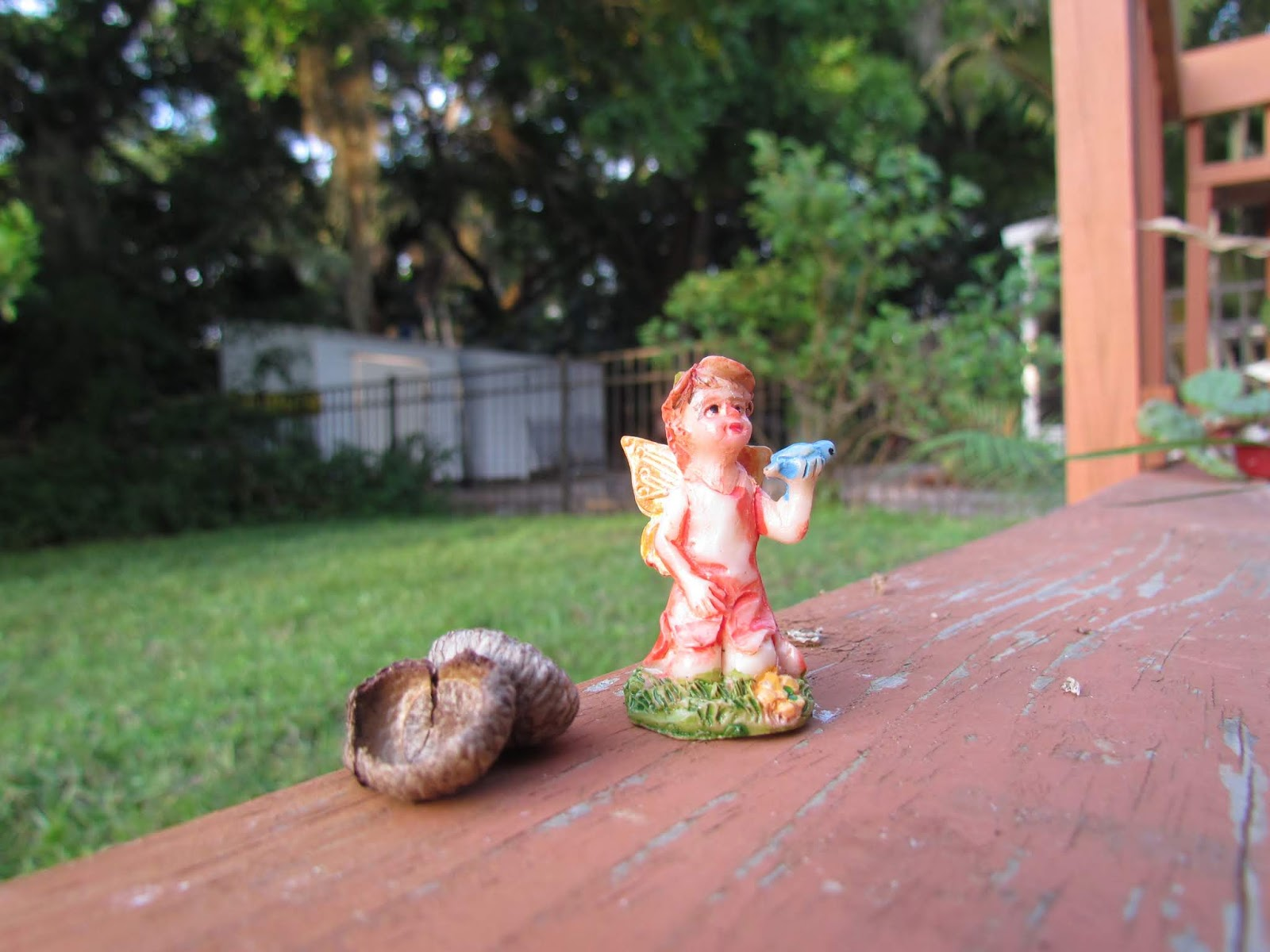 Orange Fairy Boy Figurine with Green Leaf and Brd + Acorn in Backyard in Nature