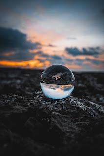 See through globe on rocks
