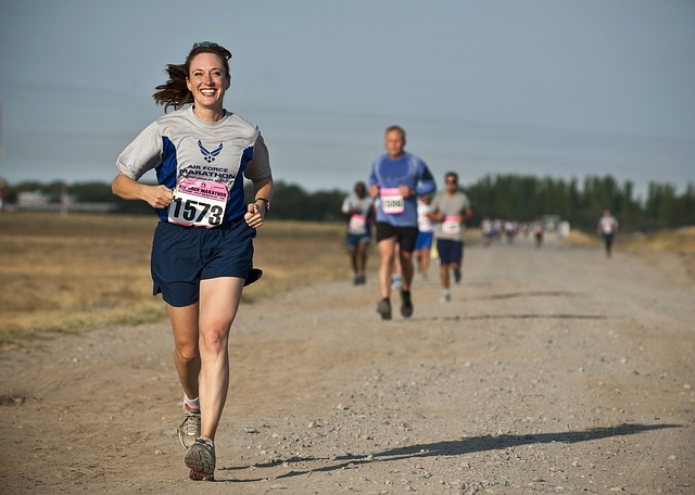 Thin Woman Running Out Ahead of Everyone Else