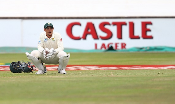 Quinton de Kock of South Africa crouches in wicket-keeping kit