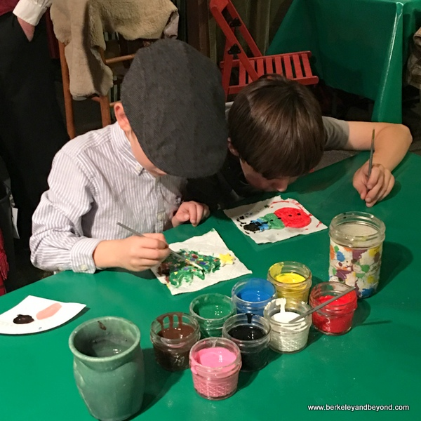 boys paint ornaments at The Great Dickens Christmas Fair in San Francisco