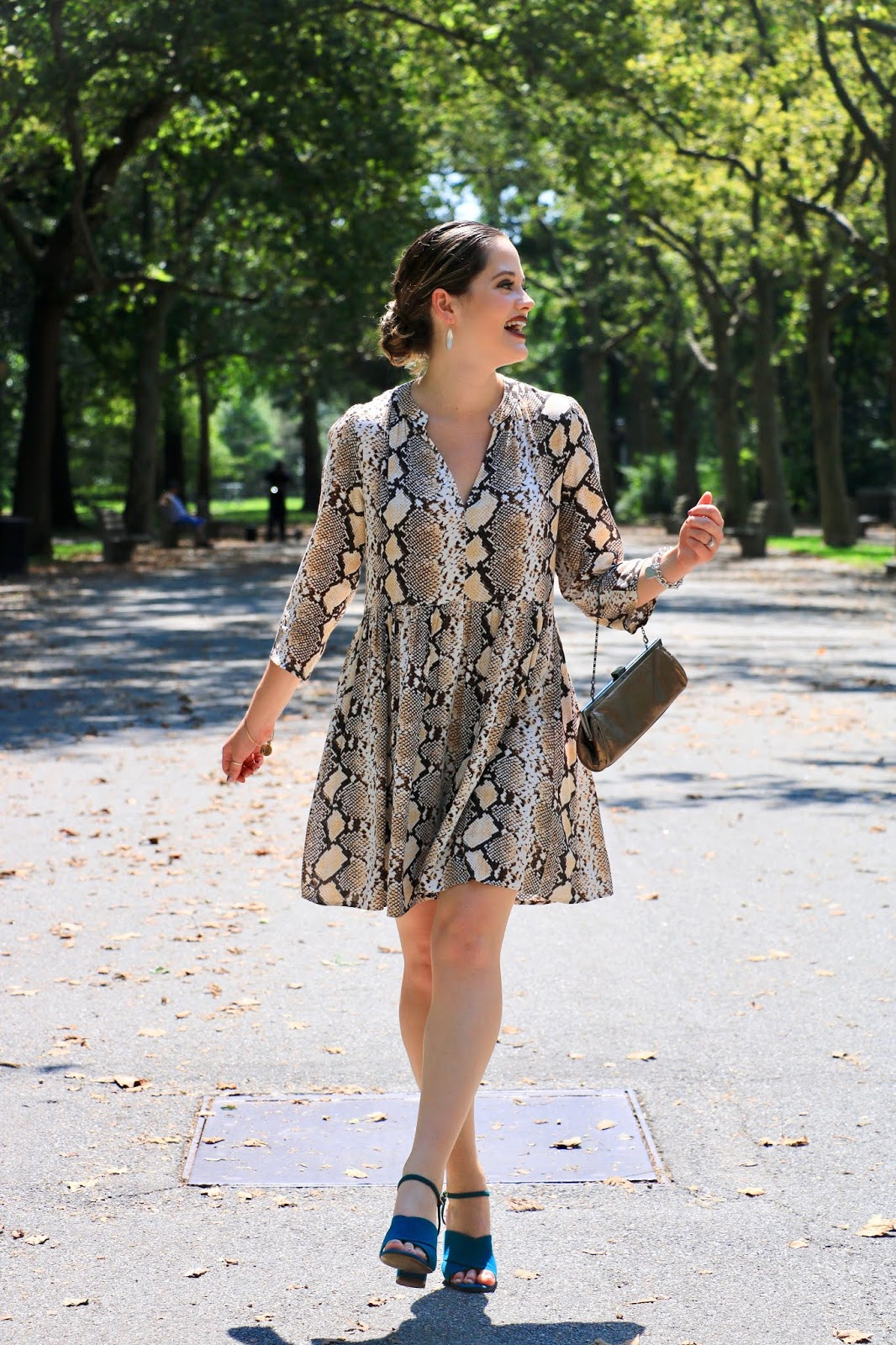 Nyc fashion blogger Kathleen Harper wearing a snake print dress for fall 2019.