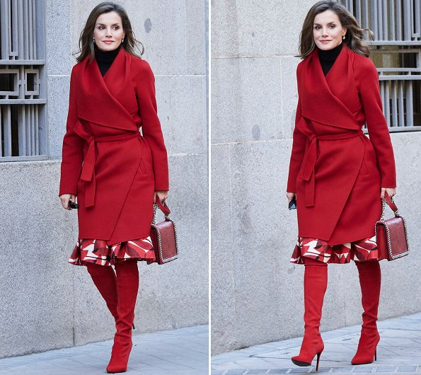 Queen Letizia wore Carolina Herrera red coat, Zara print skirt, and Zara Crossbody bag and Uterque red boots