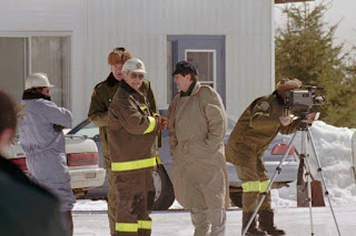 In this 1997 archival photo, investigators stand in front of a shed near a burned out house in St-Casimir, Que., where five people died. The five people are believed to be members of the Order of the Solar Temple.