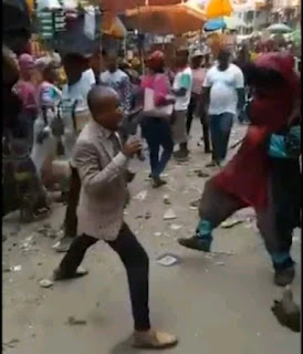 Pastor and masquerade causes outrageous scene while 'evangelizing' in market square