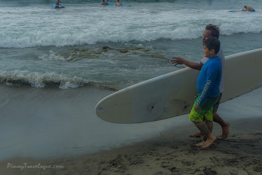 Surfing instructor instructing a kid