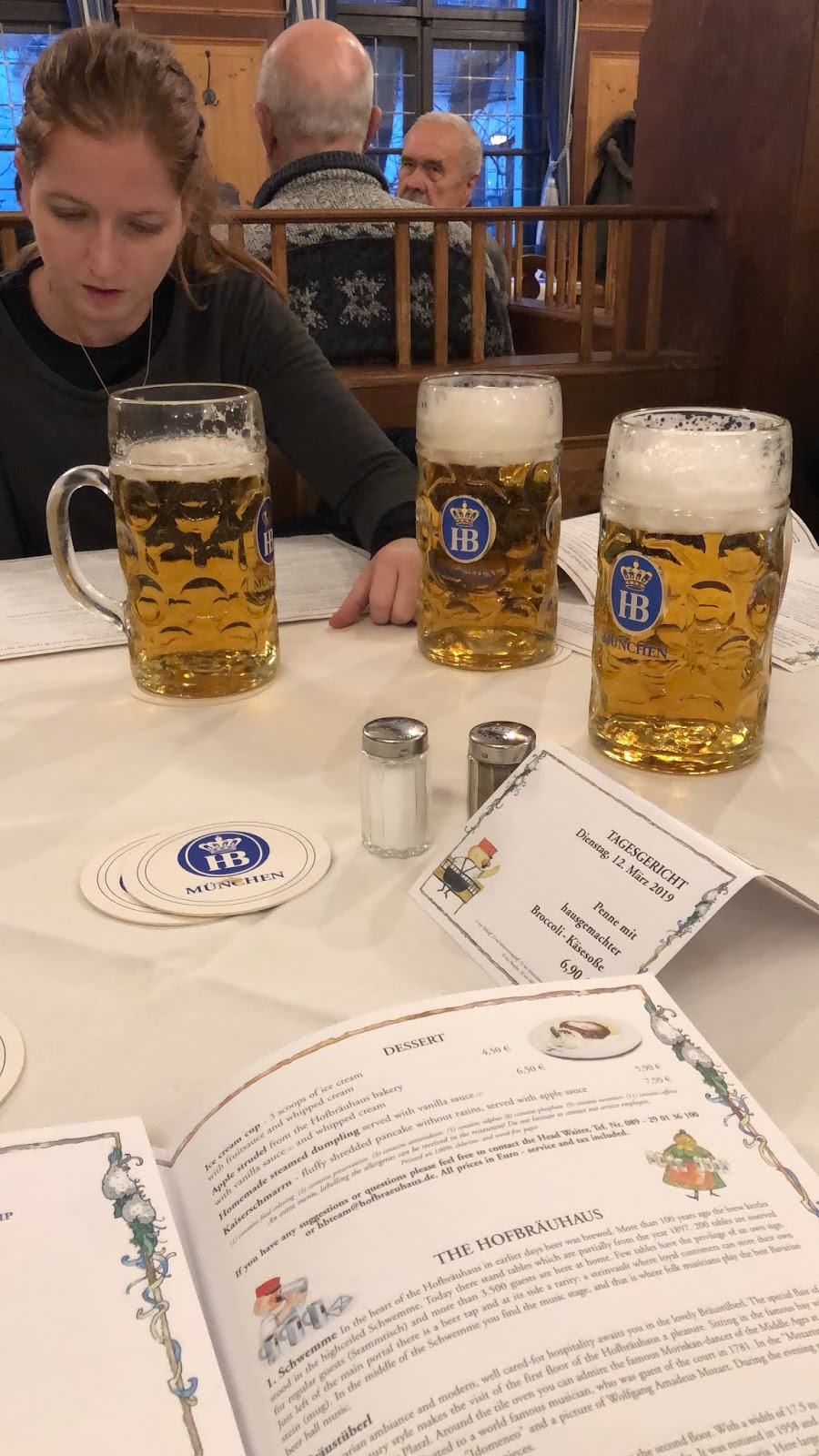 three large liters of beer in munich, germany