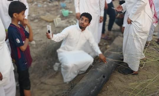 YOUNG SAUDIS TAKE SELFIE WITH HOUTHI MISSILE FRAGMENTS