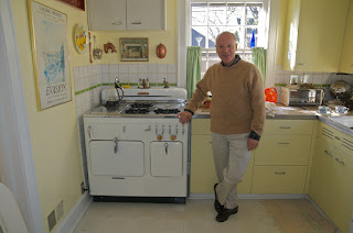 Owner of Chambers stove Model C low back in retro kitchen, Elmhurst, Illinois
