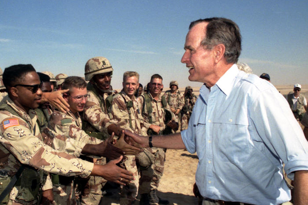 President George H.W. Bush visits U.S. troops in Saudi Arabia on Thanksgiving Day during Operation Desert Shield...on November 22, 1990.