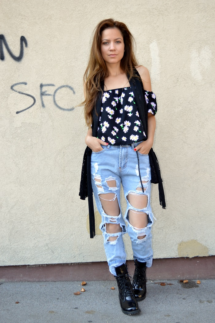 outfit, black off shoulder top with daisy print, distressed high waisted denim jeans, black combat boots, black crochet vest, dr martens boots