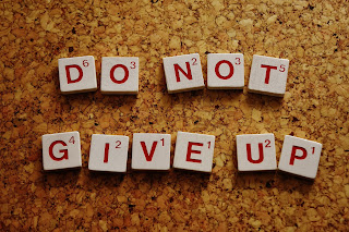 """Scrabble letters spelling """"Do Not Give Up"""""""