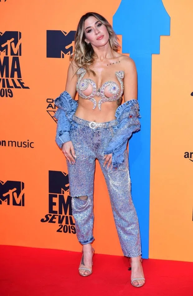 Argentinian singer J Mena arrived in a glittery denim outfit