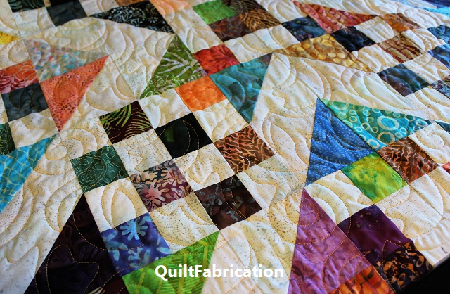 Batik scrap quilt by QuiltFabrication