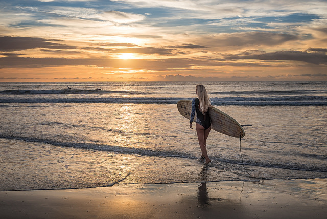 a Girl Surfing with Long Board at Cocoa Beach