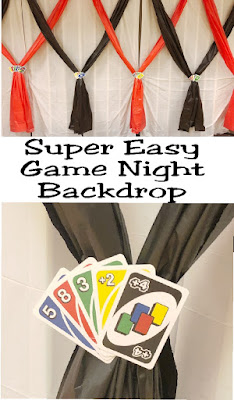 Create a fun accent wall or photo backdrop with this easy backdrop for your Game Night party. Using a few tablecloths and an old pack of Uno cards, you'll have an easy wall that will spark conversation and hide any ugly eyesores at your venue.
