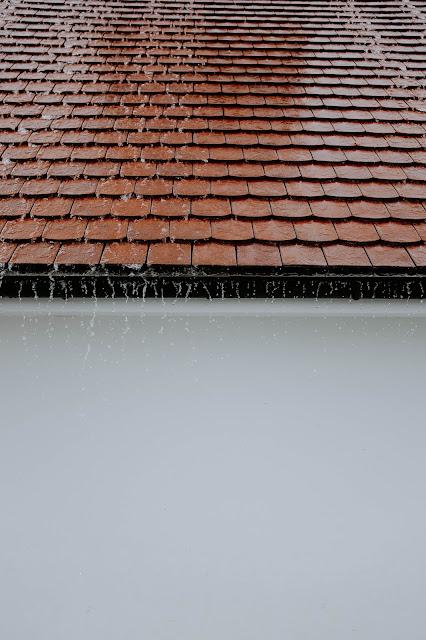 rain dripping off wet roof  Photo by Adrien Olichon on Unsplash