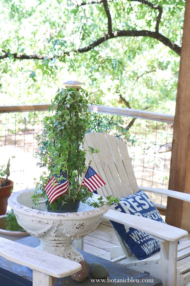 American flags add instant patriotic decor to plants and flower arrangements
