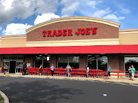 A Trader Joe's store with blue sky in background.